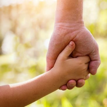 adult and child hand clasping